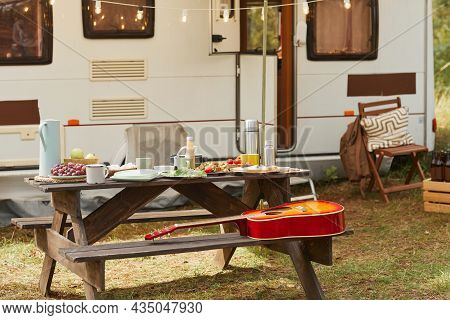 Background Image Of Cozy Outdoor Camping Area With Picnic Table And Trailer Van Decorated By Fairy L