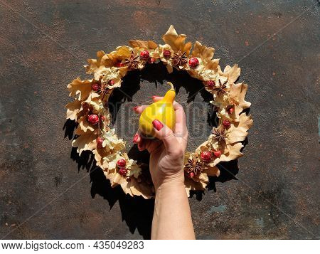 Dried Floral Wreath From Dry Autumn Leaves And Berries. Flat Lay On Dark Brown Textured Background.