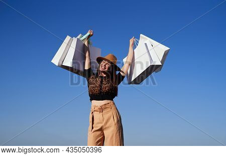 Black Friday, Retail, Consumerism Or Sale Concept. Happy Luxury Woman With Shopping Bags Above Head.