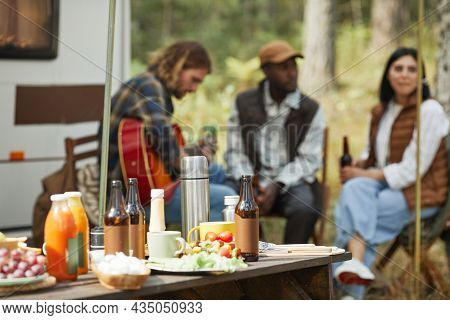 Background Image Of Wooden Picnic Table With Beer Bottles And Food At Trailer Campsite, Copy Space