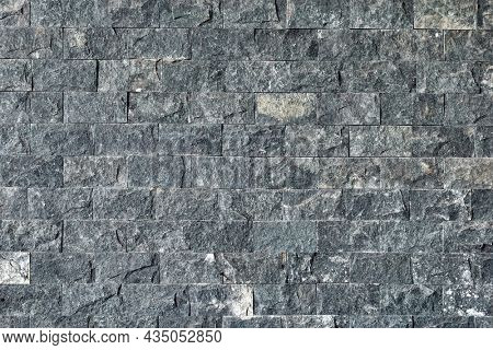 background of gray granite tiles.Grey stone texture pattern - patchwork tile  tiled background