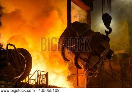 A Metallurgical Ladle Filled With Molten Metal. The Bucket Is Suspended On A Special Crane Beam.