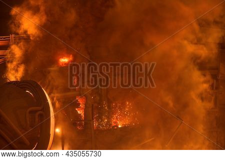 Electric Arc Furnace During Operation. Lots Of Smoke And Fire.