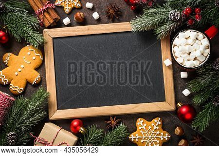 Christmas Baking Background At Dark Table. Ingredient For Cooking Christmas Cookies With Space For Y