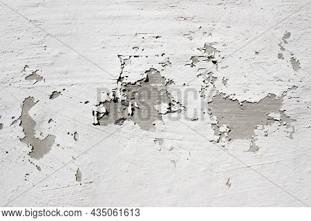 Gray Wall With Peeling Gray Paint. Old Shabby Gray Concrete Wall With Severe Damage. Rough Surface T