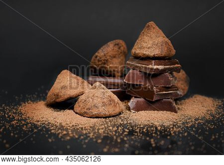 Truffle Chocolate Candies On A Dark Background. Confectionery