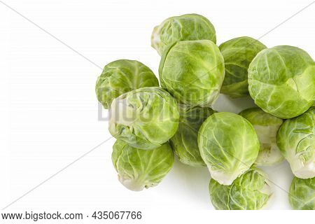 Brussels Sprouts, Isolate. Fresh, Small Brussels Sprouts Stacked In A Stack On A White Isolated Back