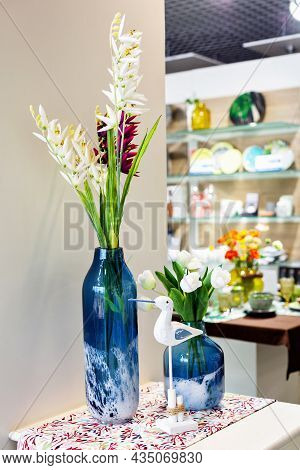Minsk, Belarus, 06 October, 2019. Modern Decor Store.two Blue Glass Vases And Wooden Bird.elegant Ac