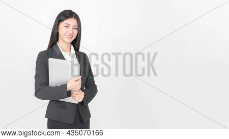 Lifestyle Business Woman , Beautiful Asian Cute Girl Wear A Business Suit Holding Laptop Computer Is