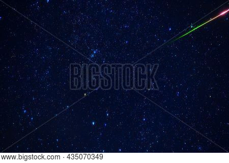 Shooting Star Meteorite Comet On Background Of Blue Dark Starry Sky With Galaxies And Nebulae