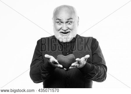 Preventing Heart Attack. Heart Problem And Healthcare. Senior Bald Head Bearded Man Hold Red Heart.