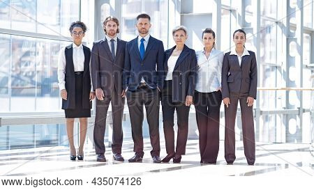 Multi Ethnic Group Of Confident Business People In Formal Wear Team Indoors Modern Building Full Len
