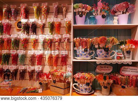 Russia, Kaliningrad Region, Svetlogorsk - June 2018: Colored Candies And Lollipops In A Showcase. In
