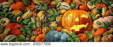 Jack-o-lantern Pumpkin As A Happy Halloween Celebration Background With Fresh Harvest Farm Squash An