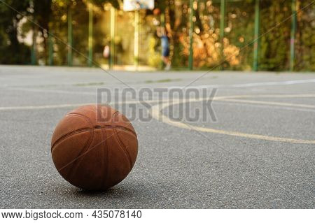 Basketball Ball On The Outdoor Sports Ground. Sports Concept