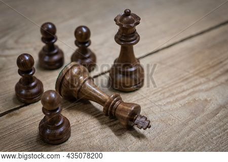 Chess Wooden Pieces On A Wooden Table