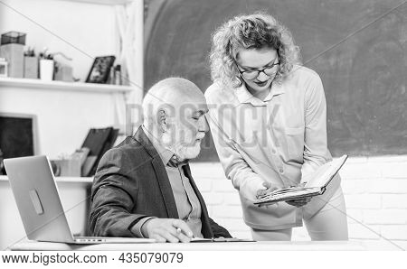 Help Me Please. Student Asking Teacher About Task. Educator And Pupil Looking At Book. Explaining Di