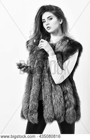 Elite Coffee Concept. Woman Splendid Makeup Wearing Luxurious Fur Coat Drinking Hot Coffee. Enjoy Lu