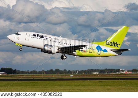 Amsterdam, Netherlands - August 15, 2014: Air Baltic Passenger Plane At Airport. Schedule Flight Tra