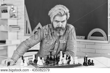 Development Logics. School Teacher. Playing Chess. Intellectual Hobby. Figures On Wooden Chess Board