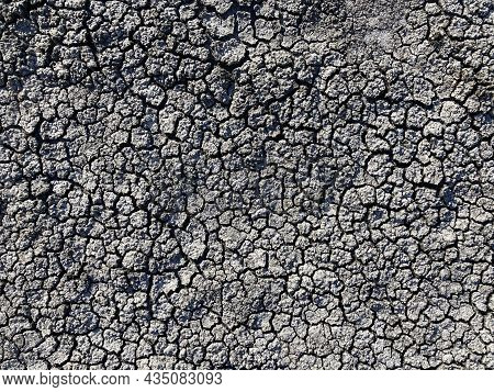 Dry And Hot Summers Dry, Cracked Soil. The Texture Of The Earth During Drought. View From The Top. T