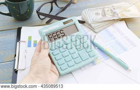 Calculator With The Word Fees On Display