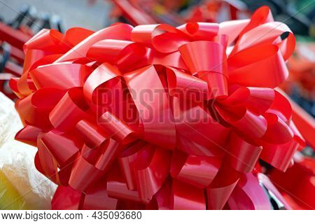 Red Ribbon Mess At Top Of Gift Packing