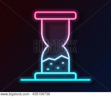 Glowing Neon Line Old Hourglass With Flowing Sand Icon Isolated On Black Background. Sand Clock Sign