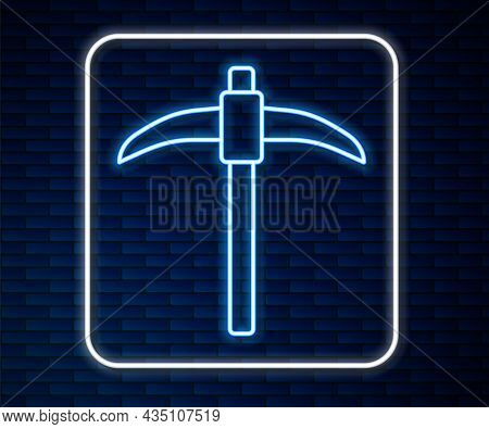 Glowing Neon Line Pickaxe Icon Isolated On Brick Wall Background. Vector