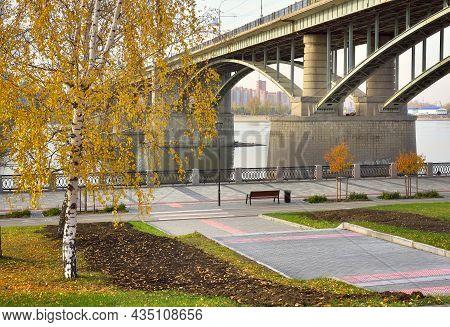 Oktyabrsky Bridge On The Ob River. Autumn Embankment Of The Capital Of Siberia