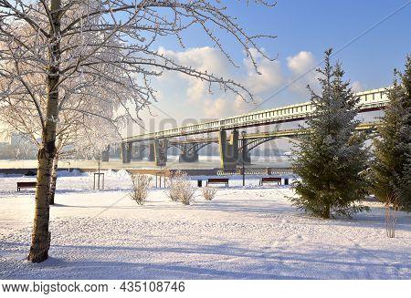 Michael's Embankment In Winter. Metro Bridge Bridge Over The Ob River Leads To A Mountain Area