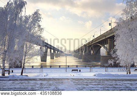 Michael's Embankment In Winter. Oktyabrsky Bridge And Metro Bridge Across The Ob Lead To The Gorsky