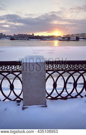 Embankment Of The River Ob In Novosibirsk. Winter Sunset At The Trans-siberian Railway Bridge