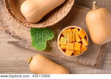 Sliced Butternut Squash In A Bowl On Wooden Preparing For Cooking, Table Top View