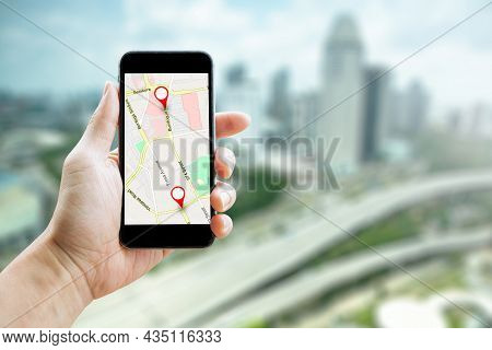 Man Hand Holding Smartphone With Gps Map To Route Destination Network Connection. Location Street Ma