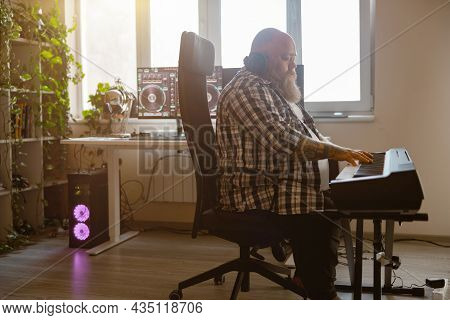 Inspired Composer Writes Music Playing Synthesizer In Home Studio