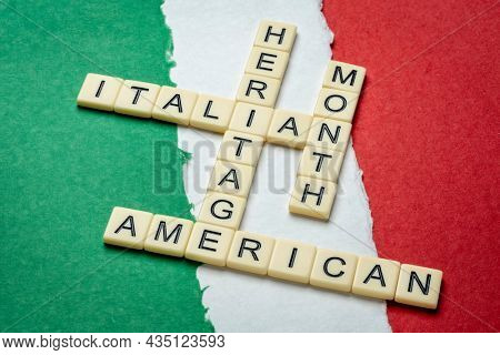 October - National Italian American Heritage Month, crossword against paper abstract in colors of national flag of Italy (green, white and red), reminder of cultural event