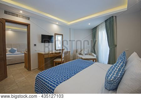 Double Bed In Family Room Suite Of A Luxury Hotel With Adjoining Bedroom