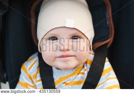 Beautiful Portrait Of A Baby In Carriage For Lifestyle Design. Funny Happy Baby. Baby Care. Outdoor
