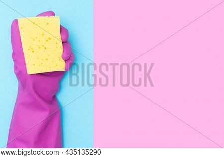 A Man In A Protective Rubber Glove Holds A Yellow Sponge. Copy Space. Cleaning Concept. Place For Yo