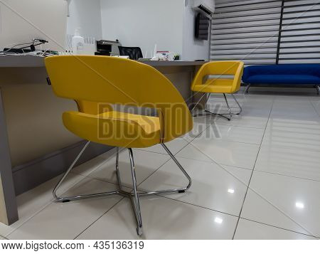 Interior Of A Modern Waiting Room With Reception Desk - Reception Area. Yellow Armchair For Clients