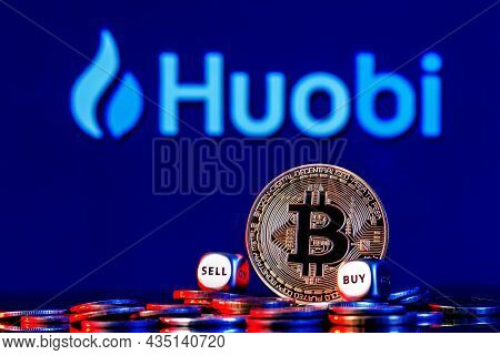 Kazan, Russia - Oct 05, 2021: Huobi Is A Cryptocurrency Exchange. Golden Bitcoin With Two Buy-sell C