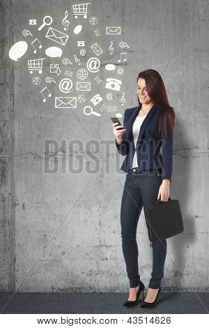Beautiful Businesswoman Browsing Internet With Smartphone