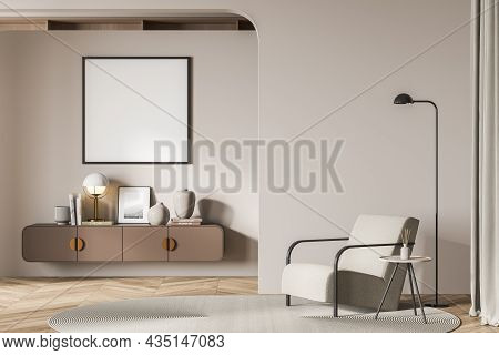 Light Living Room Interior With Armchair And Coffee Table In The Corner With Lamp, Drawer With Art D