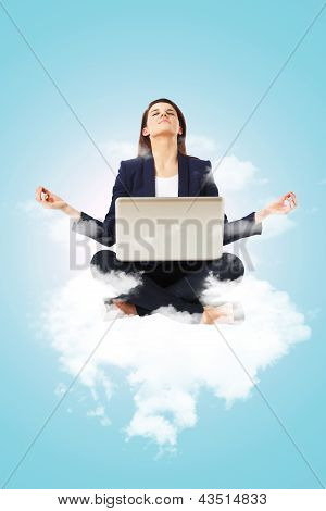 Young Businesswoman Sitting In Yoga Lotus Position With Laptop Computer