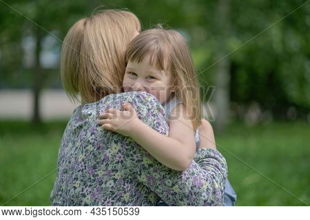 Side View Close Up Head Shot Happy Cute Daughter Hugging Embracing Cuddling Mother. Concept Of Happy