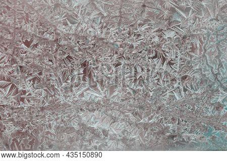 Frozen window. Crystals on a frozen window. Christmas background.