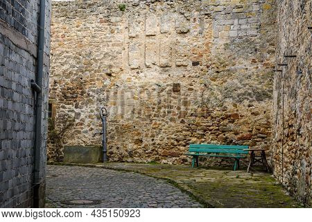 Historic Town Wall With Water Well And Bench In Freinsheim, Rhineland-palatinate, Germany