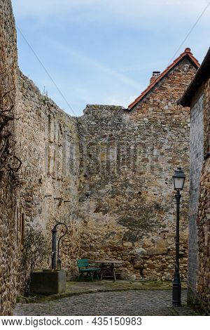 Cobblestone Alley Amidst Historic Town Wall In Old Town Of Freinsheim, Rhineland-palatinate, Germany