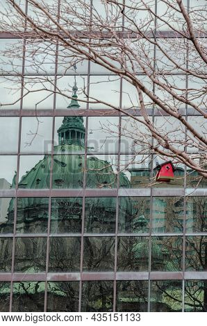 Cathedrale Marie-reine-du-monde Reflected Off The Glass Facade Of A Modern Building, Montreal, Provi